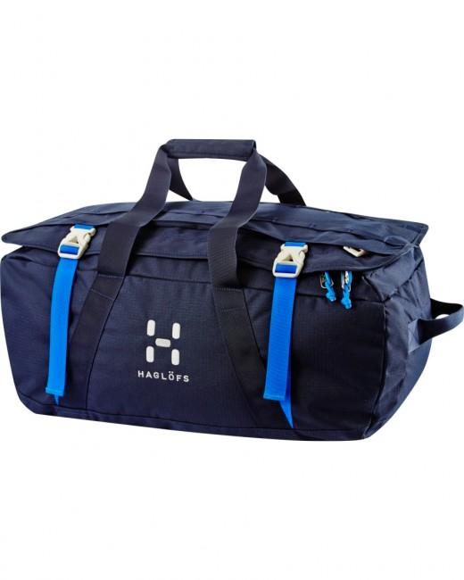 En rummelig, slidstærk og alsidig blå duffel taske i et gennemført design. Robust bærehåndtag og aftagelige skulderremme. 40 Liter. En rejsetaske til alsidig brug. Det er let og komprimerbar duffel bag, med en udvidelig flad lomme på låget. En rejsetaske som kan bæres komfortabelt på tre forskellige måder. 1 Stort låg/åbning med lynlås lommeKompression stropper1 Stort hovedrumSkulderstropperHåndstropperMateriale: 450D Polytex® RS DTY PolyesterVolumen: 40 literVægt: 665 gMål:Længde 32 cm, bredde 32 cm og højde 53cm.